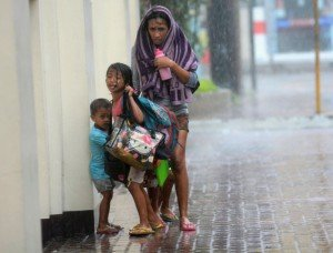 A mother takes refuge with her children as Typhoon Haiyan hits Cebu city, central Philippines November 8, 2013. Photo by Reuters/Zander Cases, courtesy Trust.org.